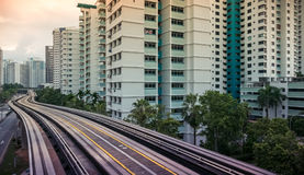 View of LRT station track serving along public residential housing apartments in Bukit Panjang. View of LRT train tracks serving public residential housing Royalty Free Stock Photos