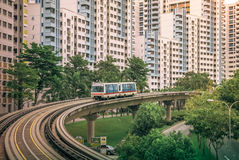 View of LRT train serving public residential housing apartments in Bukit Panjang. View of LRT train serving public residential housing apartments. The Light stock images