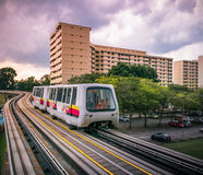 View of LRT train serving public residential housing apartments in Bukit Panjang. View of LRT train serving public residential housing apartments. The Light royalty free stock images
