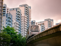 View of LRT train serving public residential housing apartments in Bukit Panjang. View of LRT train serving public residential housing apartments. The Light royalty free stock photo