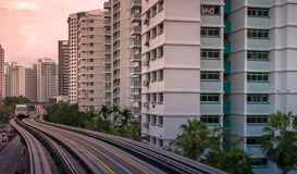 View of LRT train serving public residential housing apartments in Bukit Panjang. View of LRT train serving public residential housing apartments. The Light royalty free stock image