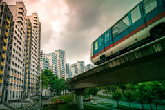 View of LRT train serving public residential housing apartments in Bukit Panjang. View of LRT train serving public residential housing apartments. The Light royalty free stock photography