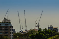 View of luffing jib tower crane at condominium construction site Royalty Free Stock Photography