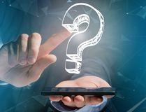 Luminous question mark displayed on a futuristic interface - Inn Royalty Free Stock Photo