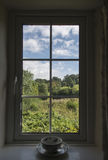 View of Lush Green Countryside Through Window Royalty Free Stock Image