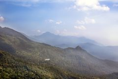 Lush Ponmudi hills and scattered sky Royalty Free Stock Photo