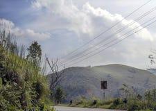 Lush green ponmudi hills and sky Royalty Free Stock Image