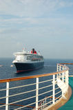 View from luxury cruise ship balcony. Unique composition of cruise ship approaching port of call Stock Image