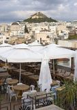 View of Lykavitos hill in from a cafe in Plaka the city of Athens, Greece royalty free stock photos
