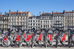 View of Lyon with bikes. LYON, FRANCE - AUGUST 2014 - Shared bikes are lined up in the streets of Lyon, France. Velo'v Grand Lyon, launched in May 2005, has over Stock Photo