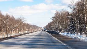 View of M1 highway in Russia in winter. View of M1 highway (Russian route M1, Belarus Highway, European route E30) in Smolensk oblast of Russia in winter day Stock Photography