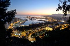 View of Málaga's port at sunset Stock Image