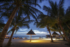 View of Mabul Island in the evening with a bamboo hut Royalty Free Stock Photography