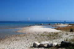 View of the Mackinac Bridge from a rocky Shore. A View of the Mackinac Bridge from a rocky Shore Stock Images