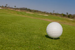 View of macro golf ball and the green golf course background Stock Photo