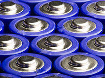 View macro of several AA blue batteries. Royalty Free Stock Photo