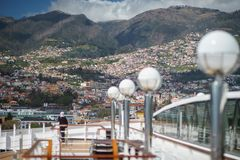 View of Madeira Island from the cruise ship with deck and woman on it foregraund.  royalty free stock photo