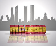 View of Madrid. Word Madrid with national flag of spain near skyline silhouette Stock Images