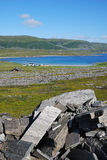 View of Mageroya with small village near the fjord. Royalty Free Stock Images