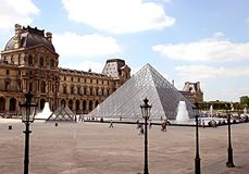 View of the main courtyard of the Louvre Palace with the glass a royalty free stock photography