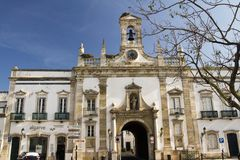Arc of the Vila. View of the main recreational plaza and Arc of Vila on the city of Faro, Portugal Royalty Free Stock Photo