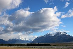 Mountains across Tasman River valley, New Zealand. View from the main road to Aoraki, Mount Cook Village looking across the Tasman River valley to snow capped Stock Photo