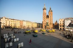 View of the Main Square. It dates to the 13th century, and at roughly 40,000 m it is the largest medieval town square in Europe. KRAKOW, POLAND - FEB 26, 2014 Stock Photo
