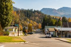 View of the main street of Concrete with the forest and mountains in the background, Washington, USA royalty free stock images