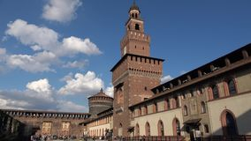 View of the main tower of the Sforza castle from the Armory yard. Milan, Italy. MILAN, ITALY - SEPTEMBER 17, 2017: View of the main tower of the Sforza castle stock video footage