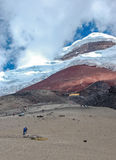 View of the majestic Cotopaxi volcano. (highest active volcano in the world) on a sunny and cloudy day Stock Photo