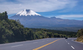 View of the majestic Cotopaxi volcano. (highest active volcano in the world) on a sunny and cloudy day Stock Photography