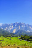 View of Majestic Mount Kinabalu with beautiful blue sky at background. Royalty Free Stock Photos