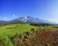 View of Majestic Mount Kinabalu with beautiful blue sky at background. Royalty Free Stock Photo