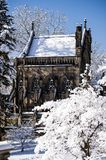 Snow Covered Gothic Chapel - Spring Grove Cemetery - Cincinnati, Ohio. A view of a majestic stone Gothic styled chapel in Spring Grove Cemetery in Cincinnati Royalty Free Stock Images