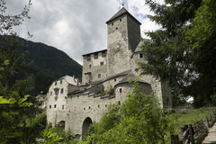 View of majestic Tures Castle and cloudy sky. Medieval fortification at the entrance to the Aurina Valley, South Tyrol Italy Royalty Free Stock Photo
