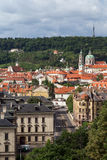 View of Mala Strana in Prague. View of old buildings at the Mala Strana District Lesser Town and Petrin Hill in Prague, Czech Republic, in the daytime Stock Image