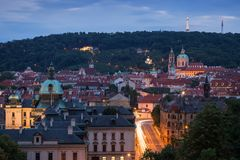 View of Mala Strana in Prague. View of old buildings at the Mala Strana District Lesser Town and Petrin Hill in Prague, Czech Republic, at dusk Stock Images