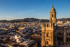 View of Malaga with the cathedral in the front. Malaga cathedral during the sunset and the panorama of the city Stock Image