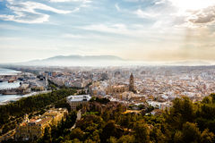 View of Malaga port, Cathedral, Alcazaba and cityscape. From height of Castillo de Gibralfaro. Costa del Sol, Andalusia, Spain royalty free stock image