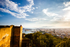 View of Malaga port, Cathedral. Alcazaba and cityscape. Tourists othe wall of Castillo de Gibralfaro. Costa del Sol, Andalusia, Spain Spain royalty free stock images