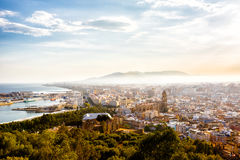 View of Malaga port, Cathedral and cityscape in the sunset. View of Malaga port, Cathedral and cityscape from height of Castillo de Gibralfaro royalty free stock photography