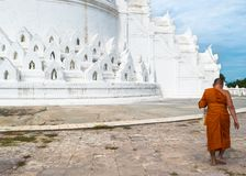 Mya Thein Tan Pagoda, Mingun, Myanmar (Burma. View of a male buddhist monk going inside the temple stock images
