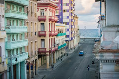 View of the Malecon from a Balcony in Central Havana, Cuba. View of the Malecon sea wall from a Balcony in Central Havana, Cuba, with a classic American car Royalty Free Stock Photos