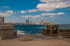 View from the Malecon promenade to the city. Cuba. Havana. View from the Malecon promenade to the city. Cuba. Havana Stock Photo