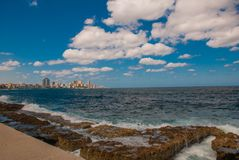 View from the Malecon promenade to the city. Cuba. Havana. View from the Malecon promenade to the city. Cuba. Havana Royalty Free Stock Photos