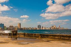 View from the Malecon promenade to the city. Cuba. Havana. View from the Malecon promenade to the city. Cuba. Havana Royalty Free Stock Images