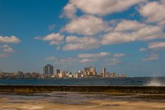 View from the Malecon promenade to the city. Cuba. Havana. View from the Malecon promenade to the city. Cuba. Havana Stock Photos