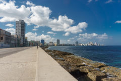 View from Malecon on sunny day from La Havana, Cuba. La Havana, Cuba: City view from Malecon on sunny day. Malecon it& x27;s the most touristic place in La Royalty Free Stock Photography