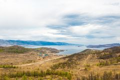 View of the Maloe More Strait, Curkut Bay and tourist centers on the shore. September. Lake Baikal, Russia. View of the Maloe More Strait, Curkut Bay and Stock Photos