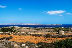 Countryside, Comino and Gozo. A view of Malta`s countryside and the islands of Comino and Gozo Royalty Free Stock Image